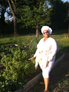 Celeta showing off the Ujamaa garden