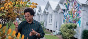 Rick Lowe in front of Project Row Houses
