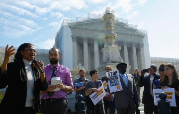 Plaintiff Esther Kiobel joins protest against Royal Dutch Shell Petroleum in front of U.S. Supreme Court in Washington